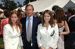 Left to right, PRINCESS BEATRICE OF YORK, MR PADDY MCNALLY and PRINCESS EUGENIE OF YORK at the 2004 Cartier International polo day at Guards Polo Club, Windsor Great Park, Berkshire on 25th July 2004.