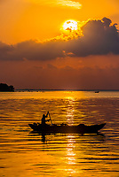 A fisherman rowing his boat at sunrise, Kinniya (near Trincomalee), Eastern Province, Sri Lanka.
