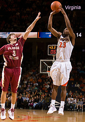 Virginia guard Jeff Jones (23) shoots over Florida State guard Luke Loucks (3).  The Virginia Cavaliers fell to the Florida State Seminoles 73-62 in NCAA Basketball at the John Paul Jones Arena on the Grounds of the University of Virginia in Charlottesville, VA on January 24, 2009.