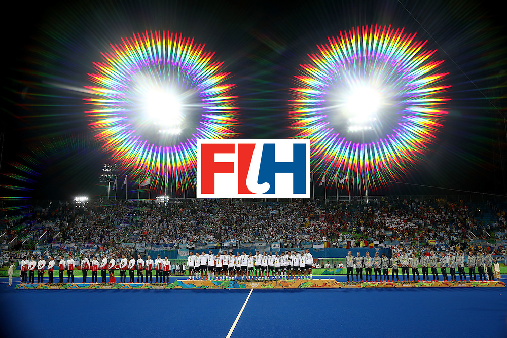 RIO DE JANEIRO, BRAZIL - AUGUST 18:  (EDITORS NOTE: A special effects camera filter was used for this image.) Silver medalists Team Belgium, gold medalists Team Argentina and bronze medalists Team Germany pose on the podium during the medal ceremony for the Men's Hockey Gold Medal match between Belgium and Argentina on Day 13 of the Rio 2016 Olympic Games at Olympic Hockey Centre on August 18, 2016 in Rio de Janeiro, Brazil.  (Photo by Clive Brunskill/Getty Images)