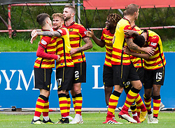 Partick Thistle Andrea Mbuyi-Mutombo (centre right) celebrates scoring his side's first goal of the game during the Betfed Cup Second Round match at the Energy Check Stadium at Firhill, Glasgow.