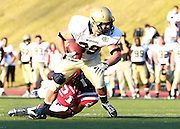 Samford defensive back Alvin Hines II tackles  Wofford Brad Nocek in overtime at Seibert Stadium in Homewood, Ala., Saturday, Oct 13, 2012. Samford defeats Wofford 24-17 in Overtime. (Marvin Gentry)