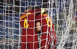 October 25, 2017 - Rome, Italy - Roma Diego Perotti, right, is hugged by his teammate Radja Nainggolan after scoring the winning goal on a penalty kick during the Serie A soccer match between Roma and Crotone at the Olympic stadium. Roma won 1-0. (Credit Image: © Riccardo De Luca/Pacific Press via ZUMA Wire)