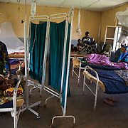 A women's ward at the Geita district hospital. Geita, the heart of the lucrative gold mining industry in Tanzania, remains a largely impoverished area with poor quality facilities, like the local hospital.