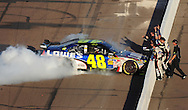 Nov. 15, 2009; Avondale, AZ, USA; NASCAR Sprint Cup Series driver Jimmie Johnson celebrates after winning the Checker O'Reilly Auto Parts 500 at Phoenix International Raceway. Mandatory Credit: Jennifer Stewart-US PRESSWIRE
