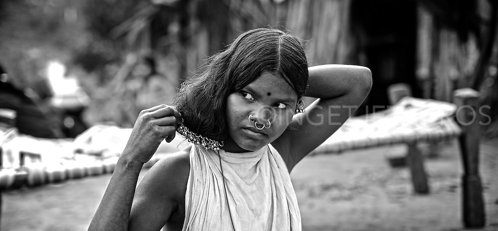 The tribal girls from the Dongria Kondh tribe wear many metal pins and bells in their hair.