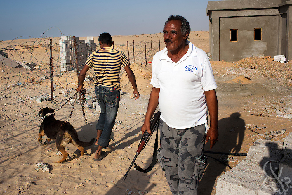 Armed Bedouin watchmen Fayez Eid (r) and Mohamed Ouda stand guard July 26, 2011 outside a recently bombed natural gas pumping station, one of more than a dozen located just outside the North Sinai town of Areesh, Egypt (40 kilometers from the border with Israel.) Since the Egyptian revolution, a decline in the number of police across the Sinai has resulted in a boom in the smuggling business and a spate of bombings targeting the natural gas export pipeline to neighboring Israel..Slug: Sinai.Credit: Scott Nelson for the new York Times