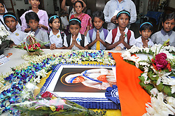 September 5, 2017 - Kolkata, West Bengal, India - Indian orphanage  Children's pray at the tomb of Mother Teresa at a service to commemorate the 20th death anniversary of Mother Teresa at the Missionaries of Charity house in Kolkata. Pope Francis on September 4, 2016 proclaimed Mother Teresa a saint, hailing her work with the destitute of Kolkata as a beacon for mankind and testimony of God's compassion for the poor. The revered nun's elevation to Roman Catholicism's celestial pantheon came in a canonisation mass in St Peter's square presided over by Pope Francis, (Credit Image: © Debajyoti Chakraborty/NurPhoto via ZUMA Press)