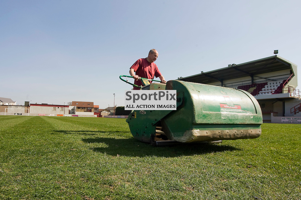 Groundsmen work on the pitch at Linlithgow Rose Prestonfied Park. The gound has hosted the Scotland and Australia senior squads for training sessions as well as the Scotland womans international side on several occasions. The club qualified for the Scottish Cup when they were awarded an SFA license in 2014<br /> (c) Andrew West   SportPix.org.uk