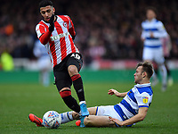 Football - 2019 / 2020 Sky Bet (EFL) Championship - Brentford vs. Queens Park Rangers<br /> <br /> Brentford's Said Benrahma is fouled by Queens Park Rangers' Todd Kane, at Griffin Park.<br /> <br /> COLORSPORT/ASHLEY WESTERN