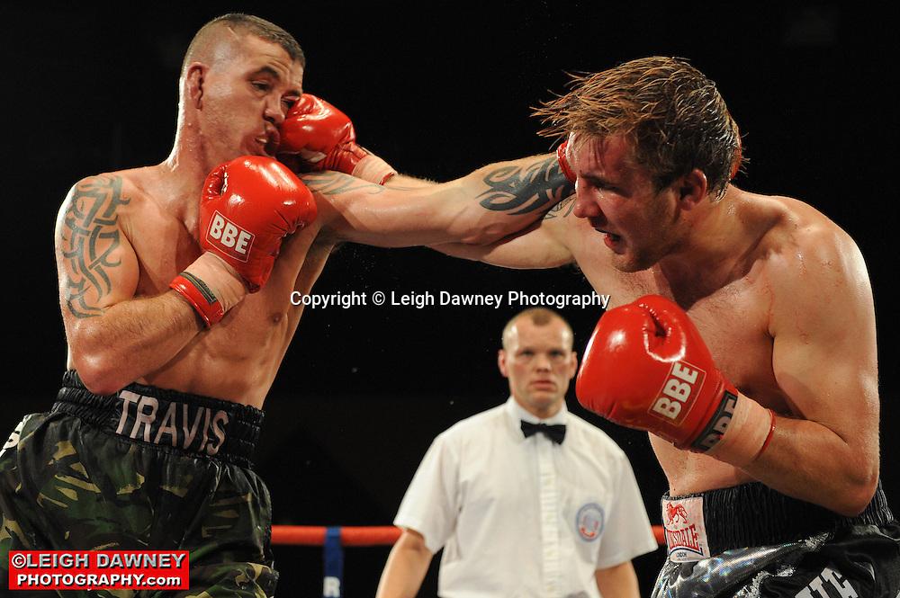 Travis Dickinson (camouflage shorts)) defeats Shon Davies at Rainton Meadows Arena, Sunderland, 11th September 2010. Frank Maloney Promotions. © Photo credit: Leigh Dawney