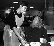 Roma 1996.Un  ospite italiano della Mensa Caritas  con una volontaria.A guest of the refectory Caritas