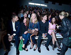 © Licensed to London News Pictures. 15/09/2012. London, UK.  Former Model Jodie Kidd (centre) and Kelly Brook (right) with boyfriend Thom Evans at Issa London catwalk show at London Fashion Week Spring/Summer 2013 on September 15, 2012. Photo credit : Ben Cawthra/LNP
