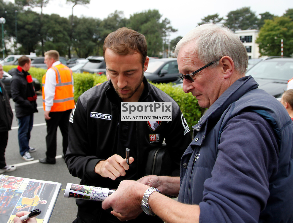 Glen Murray signs a programme for a fan before Bournemouth vs Watford on Saturday 3rd of October 2015.