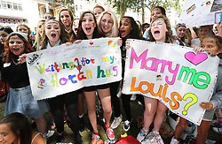 One Direction fans get in the mood as they wait in Leicester Square in London for the world premiere of the bands film One Direction: This Is Us,Tuesday, 20th August 2013. Picture by Stephen Lock / i-Images