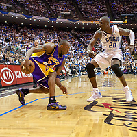 BASKET BALL - PLAYOFFS NBA 2008/2009 - LOS ANGELES LAKERS V ORLANDO MAGIC - GAME 3 -  ORLANDO (USA) - 09/06/2009 - PHOTO : CHRIS ELISE<br /> KOBE BRYANT (LAKERS), MICKAEL PIETRUS (MAGIC), PHIL JACKSON