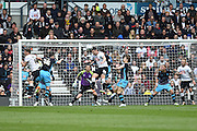 Derby County defender Jason Shackell jumps for a header during the Sky Bet Championship match between Derby County and Sheffield Wednesday at the iPro Stadium, Derby, England on 23 April 2016. Photo by Jon Hobley.
