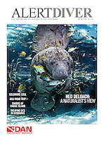 Winter 2014 cover of Alert Diver Magazine, Dan.org. Manatee surrounded by fish photograph by Carol Grant, oceangrant.com.