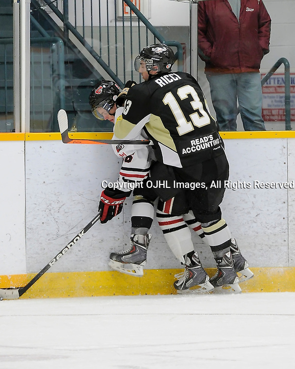 TRENTON, ON - Oct 29 : Ontario Junior Hockey League Game Action between Trenton Golden Hawks and Milton Icehawks, Fabrizio Ricci #13 of the Trenton Golden Hawks Hockey Club makes the hit on Stephen Templeton #13 of the Milton Ice Hawks Hockey Club<br /> (Photo by Amy Deroche / OJHL Images)