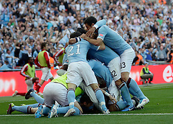 14.05.2011, Wemblay Stadium, ENG, FA CUP FINALE, Manchester City vs Stoke City im Bild Scorer for city Manchester City's  Yaya Toure celebrates his goal with Manchester City's Mario Balotelli  and team mates     during   the 130th  FA Cup Final  between Manchester City and Stoke City at Wembley Stadium in London    on 14/05/2011, EXPA Pictures © 2011, PhotoCredit: EXPA/ IPS/ M. Pozzetti *** ATTENTION *** UK AND FRANCE OUT!