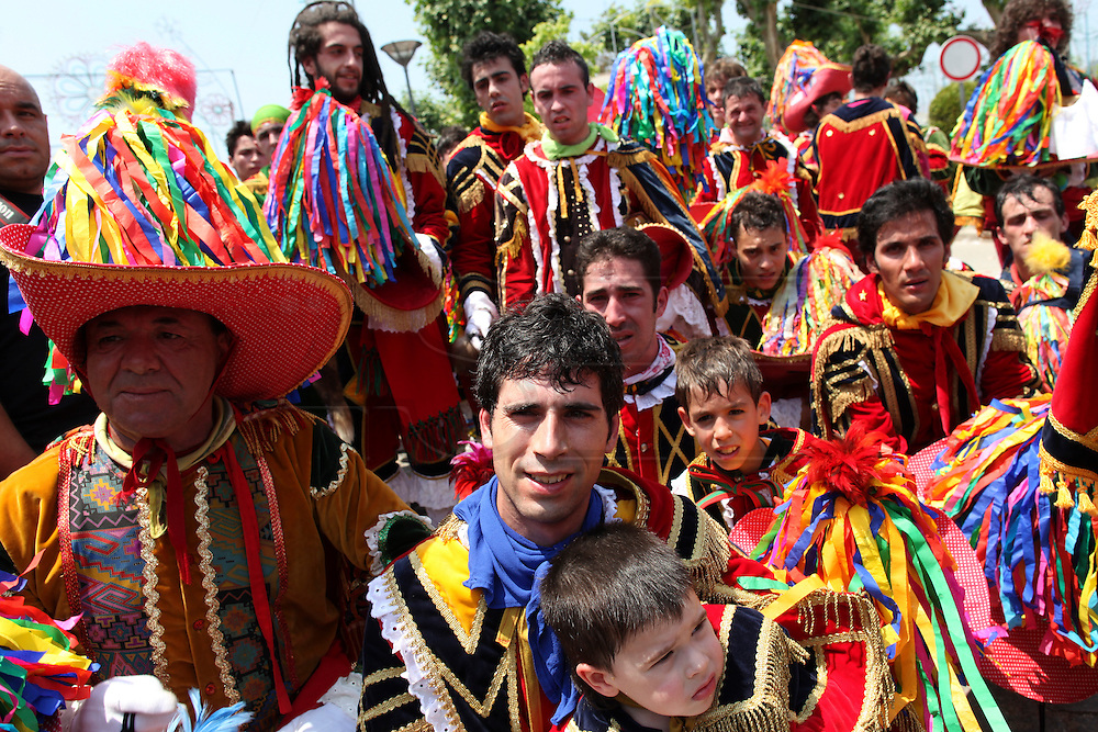 """The night of São João (Saint John), in Valongo - nearby Porto - is celebrated in a peculiar way. This commemoration day of St. John, is a traditional celebration inspired by a secular legend. Groups of men dressing up in costumes, dance the so  called """"Dance of the bugios"""". In the middle there is a King, who is the king of """"bugios"""", all together they celebrate the  medieval legend that says : """" The daughter of a Moorish king who lived there got sick and the king appealed to scholars and healers to cure her. Having no results and his daughter continued to languish, he called on Christians to ask for his daughter and prayed to the image o St. John. The Princess was cured and there was a procession to worship the image of St. John, what the Moors called the possession of the holy, to thank for this miracle."""" The festivities recreate that moment."""