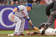 New York Mets shortstop Asdrubal Cabrera (13) lays a tag on San Francisco Giants catcher Trevor Brown (14) during an attempted steal at AT&T Park in San Francisco, Calif., on August 21, 2016. (Stan Olszewski/Special to S.F. Examiner)