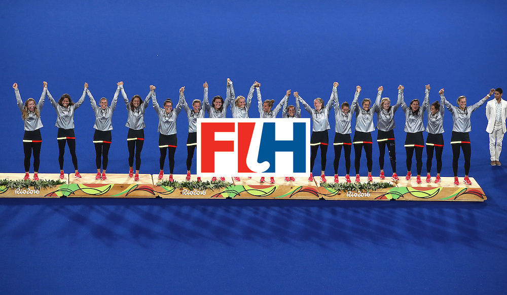 RIO DE JANEIRO, BRAZIL - AUGUST 19:  Germany pose on the podium during the medal ceremony after winning Bronze in the Women's Hockey on Day 14 of the Rio 2016 Olympic Games at the Olympic Hockey Centre on August 19, 2016 in Rio de Janeiro, Brazil.  (Photo by Mark Kolbe/Getty Images)