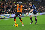Hull City midfielder Mohammed Diame and Bolton Wanderers defender Robert Holding fight for ball  during the Sky Bet Championship match between Hull City and Bolton Wanderers at the KC Stadium, Kingston upon Hull, England on 12 December 2015. Photo by Ian Lyall.