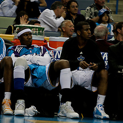 27 April 2009: New Orleans Hornets guard Chris Paul (right) sits with teammates James Posey (center) and Rasual Butler (left) after coming out of the game in the fourth quarter during a 121-63 win by the Denver Nuggets over the New Orleans Hornets in game four of the NBA Western Conference Quarterfinals playoff game played at the New Orleans Arena in New Orleans, Louisiana.