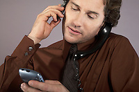 Multi-tasking businessman using mobile phone