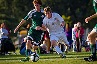St. Maries High Sean Brannigan, left, tries to keep his on track to the ball as he is leaned on by Bonners Ferry High's Hayden Wakkinen in the first half of the 3A Region 1 tournament championship game Thursday in Rathdrum.
