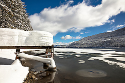 """Snowy Dock on Donner Lake"" - Photograph of a heavily snow covered dock on a partially frozen over Donner Lake in Truckee, California."