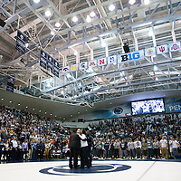 February 23, 2014; State College, PA, USA; Penn State head coach Cael Sanderson hugs Thanayi Ruth after her son, senior Ed Ruth, was introduced to a sell-out crowd at Rec Hall during senior recognition before the Nittany Lions match against the Clarion Eagles. Penn State defeated Clarion 43-3.