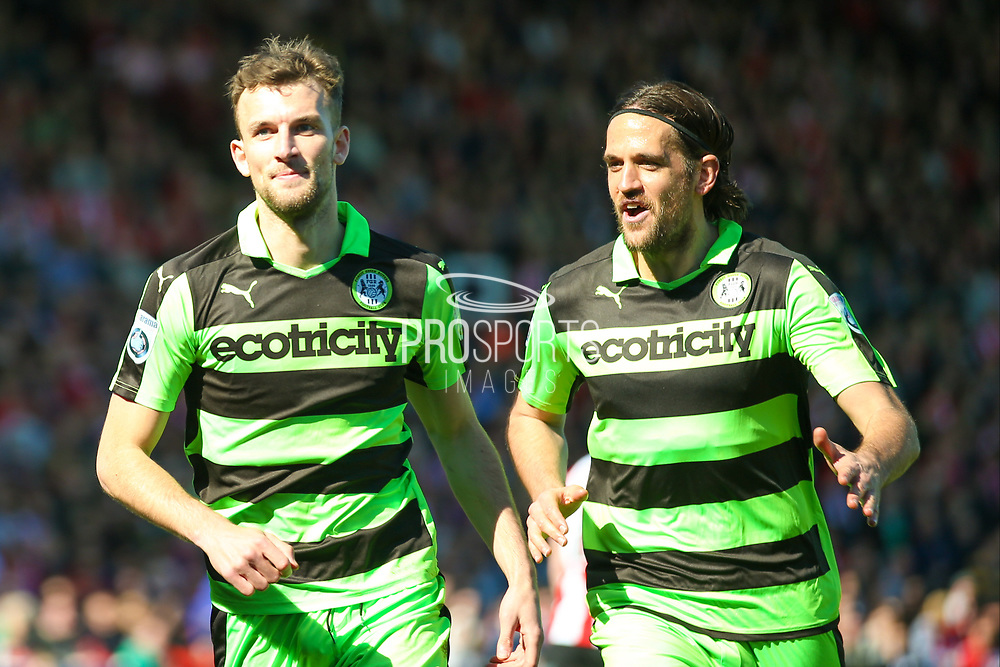 Forest Green Rovers forward Christian Doidge (9) scores a goal and celebrates to make the score 0-1 during the Vanarama National League match between Lincoln City and Forest Green Rovers at Sincil Bank, Lincoln, United Kingdom on 25 March 2017. Photo by Simon Davies.