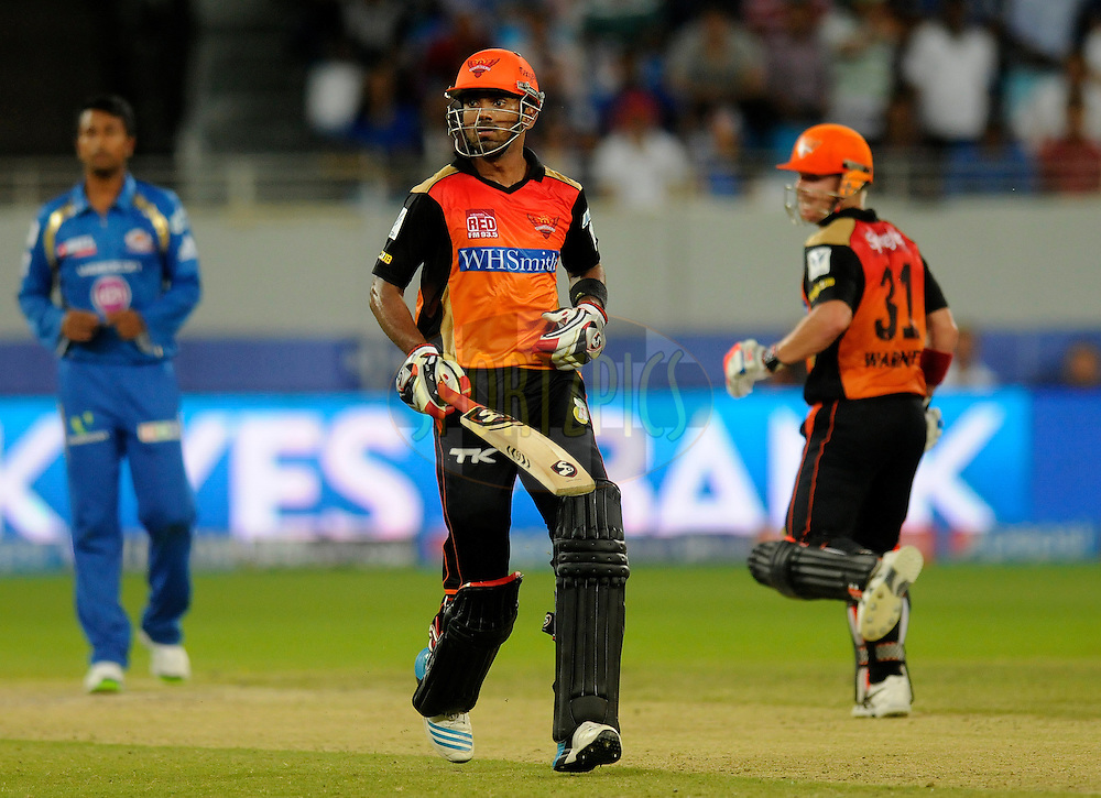 K.L Rahul of the Sunrisers Hyderabad runs between the wickets during match 20 of the Pepsi Indian Premier League Season 2014 between the Mumbai Indians and the Sunrisers Hyderabad held at the Dubai International Stadium, Dubai, United Arab Emirates on the 30th April 2014<br /> <br /> Photo by Pal Pillia / IPL / SPORTZPICS