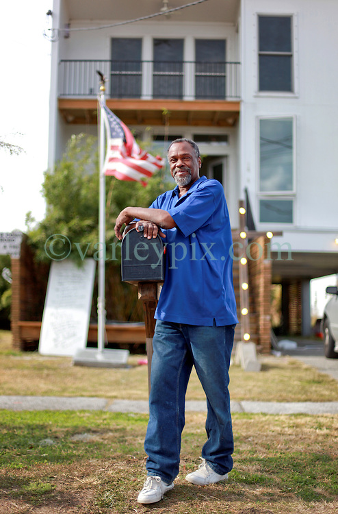 03 December 2013. Lower 9th Ward, New Orleans, Louisiana. <br /> Robert Green stands in front of his Brad pitt 'Make it Right' home on Tennessee Street. <br /> Photo; Charlie Varley