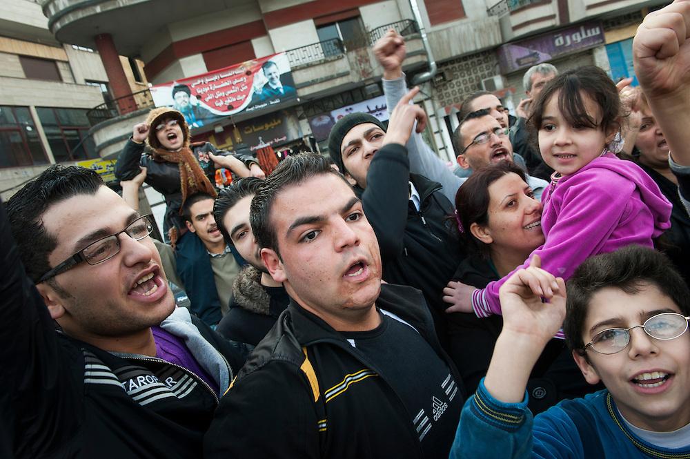 January 11, 2012, Homs, Syria. Demonstrators in favor of Bachar el-Assad demonstrate in the Hadara district in Homs  during the civil war. <br /> <br /> 11 janvier 2012, Homs, Syrie. Manifestants en faveur de Bachar el-Assad dans in la quartier Hadara pendant la guerre civile.
