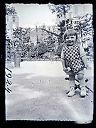 happy smiling little girl in a park France circa 1920s