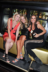Left to right, MEREDITH OSTROM, SILJE VALLEVIK and SASHA VOLKOVA at the Johnnie Walker Gold Label Reserve Launch Party at Whisky Mist, 35 Hertford Street, London on 18th July 2012.