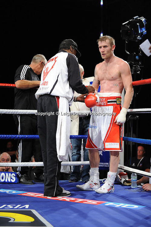 Tony Jeffries (pictured with trainer) defeats Paul Morby in a Light Heavyweight contest at the Doncaster Dome, Doncaster, UK, 3rd September 2011. Frank Maloney Promotions. Photo credit: Leigh Dawney 2011