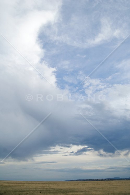 Cloudy sky over high desert plains in New Mexico