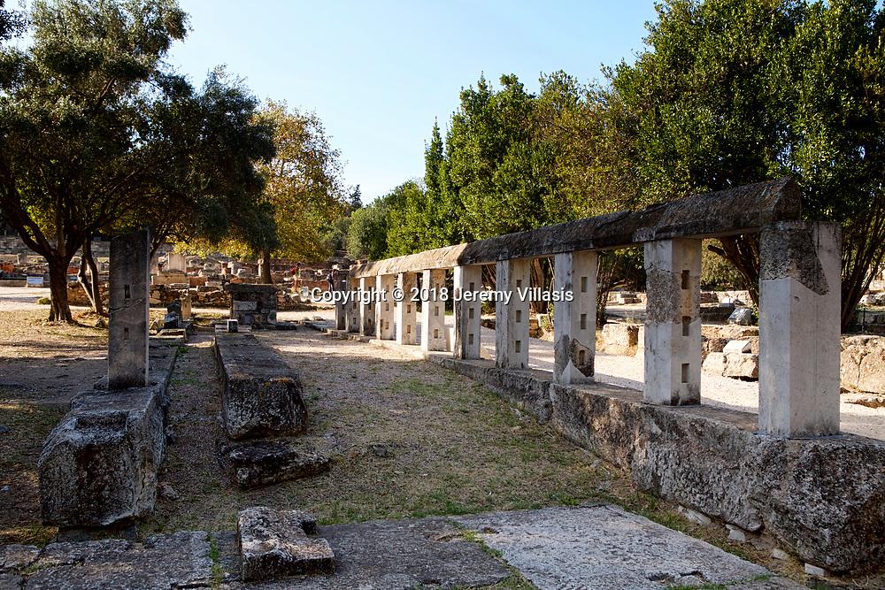 The Monument of the Eponymous Heroes in the Ancient Agora was a marble podium that once bore the bronze statues of mythical heroes of each of the ten Athenian tribes.