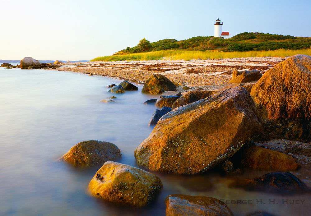 1001-1002 ~ Copyright:  George H. H. Huey ~ Tarpaulin Cove Lighthouse, Naushon Island, constructed 1891.  Vineyard Sound with the island of Martha's Vineyard in distance.  Massachusetts.