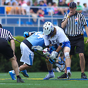 Duke Midfielder Brendan Fowler (3), RIGHT, faces-off with Johns Hopkins Midfielders Robert Enright (34), LEFT, during the second half of The NCAA Division I Men's Lacrosse Tournament game between the Defending national champion Duke and No. 8 ranked Johns Hopkins Sunday, May. 18, 2014 at Delaware Stadium in Newark, DEL