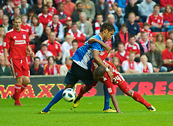 LIVERPOOL, ENGLAND - Thursday, August 5, 2010: Liverpool's David Ngog is fouled in the Penalty area by FK Rabotnicki's Fernando Lopes for a penalty during the UEFA Europa League 3rd Qualifying Round 2nd Leg match at Anfield. (Pic by: David Rawcliffe/Propaganda)