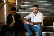 Oscar De La Hoya checks his phone while waiting for their car after the weigh-ins at AT&T Stadium in Arlington, Texas on September 16, 2016.  (Cooper Neill for ESPN)
