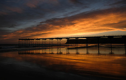 © Licensed to London News Pictures. <br /> 29/09/2016. <br /> Saltburn-by-the-Sea, UK.  <br /> <br /> A dramatic dawn sky can is seen over the pier and beach at Saltburn by the Sea.<br /> <br /> Photo credit: Ian Forsyth/LNP