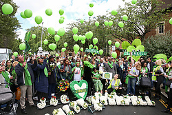 © Licensed to London News Pictures. 14/06/2019. London, UK.  Survivors, family and friends of the victims wear symbolic green scarves to commemorate the second anniversary of the Grenfell Tower fire. On 14 June 2017, just before 1:00am a fire broke out in the kitchen of the fourth floor flat at the 24-storey residential tower block in North Kensington, West London, which took the lives of 72 people. More than 70 others were injured and 223 people escaped. Photo credit: Dinendra Haria/LNP
