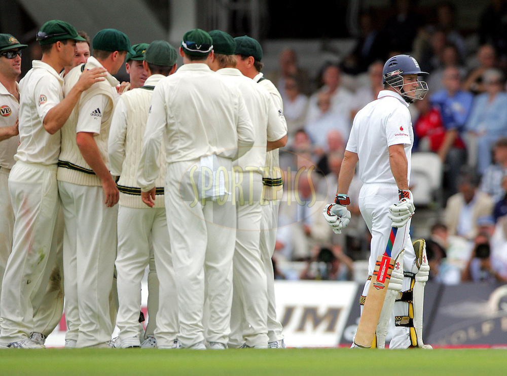 © SPORTZPICS / Seconds Left Images 2009  - Andrew Strauss leaves the field (R) as Australia celebrate his wicket bowled by Ben Hilfenhaus caught Brad Haddin for 55 runs    England v Australia - The Ashes 2009 - 5th npower Test  Match - Day 1 - 20/08/09 - The Brit Oval - London -  UK - All Rights Reserved