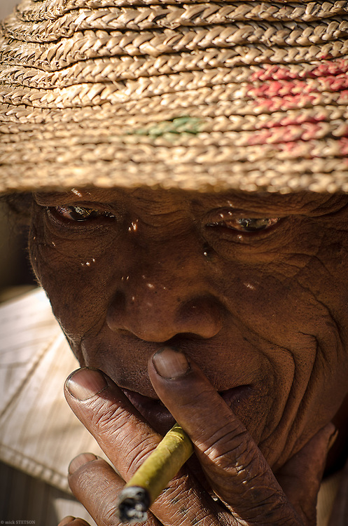 — Inle fisherman smoking a cheroot, a traditional hand-rolled cigar.